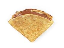 Frische selbst gemachte Blinis mit Draufsicht der Schokoladencreme lokalisiert auf Weiß Lizenzfreies Stockfoto