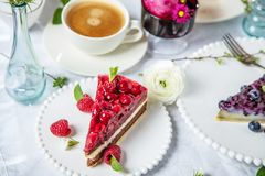 A delicious homemade cake with raspberry on a wooden table stock image
