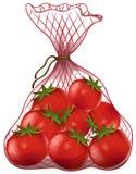 Frische Tomaten in der Nettotasche Lizenzfreies Stockbild