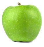 Frischer grüner Apfel mit Schatten auf einem weißen Hintergrund Stockbilder