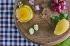 Frischer Mangofruchtsaft Stockfoto