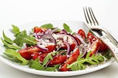 Frischer Salat auf einer Platte Lizenzfreies Stockfoto