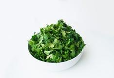 Frischer Spinat getrennt auf Weiß Stockbild