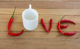 Frisches corlor rote Pfeffer, die als das Wort vereinbart werden, lieben Stockbilder