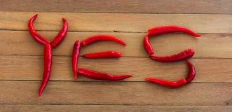 Frisches corlor rote Pfeffer JA vereinbart als das Wort Lizenzfreie Stockbilder