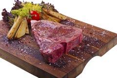 Frischfleisch auf einem weißen Hintergrund. Lizenzfreie Stockfotos