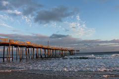 Frisco NC Fishing Pier. Remaining portions of a fishing pier in NC stand precariously after withstanding several hurricanes and severe storms Stock Image