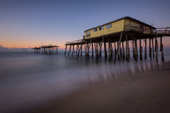 Frisco Pier, Outer Banks, North Carolina. Predawn glow and the old abandoned Frisco Pier along North Carolina's Outer Banks Royalty Free Stock Photo
