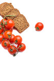 Frish bread with cerry tomatoes Stock Photos