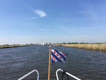 Frisian flag. At a boat in the Jeltesleat in Friesland The Netherlands Stock Photography