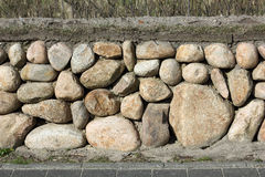 Frisian stone wall on the island of Sylt, Germany Royalty Free Stock Photo