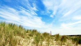 Frisianeiland Ameland met vuurtoren op achtergrond royalty-vrije stock afbeelding