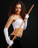 Frisky woman with a stick. Royalty Free Stock Image