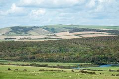 Friston Forest and Fore Down Across Cuckmere Valley in Sussex. Friston Forest and Fore Down across the Cuckmere Valley in Sussex Royalty Free Stock Photography