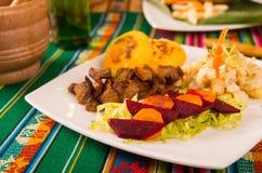 Fritada, fried pork, traditional ecuatorian dish. Royalty Free Stock Images