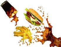 Fritadas do cheeseburger, da cola e do francês imagem de stock