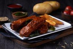 Fritadas dos reforços de carne de porco imagens de stock