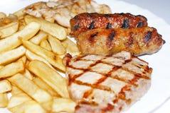 Fritadas e carne Fotos de Stock
