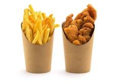 Fritadas y pepitas de pollo imagen de archivo