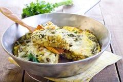 Fritata della patata e degli spinaci Fotografie Stock