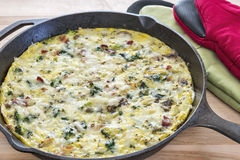 Fritata made with broccoli, bacon, spinach and mushrooms Royalty Free Stock Image