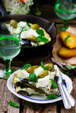 Fritatta with eggplants, cheese and olives. Royalty Free Stock Images