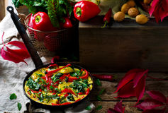 Fritatta with potato, pepper, and swiss chard. Royalty Free Stock Photography