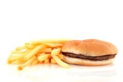 Frites e Hamburger fritados Foto de Stock
