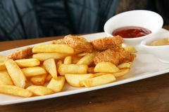 Frites and nuggets Stock Photography