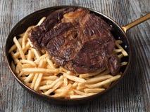 Frites rustici della bistecca Immagine Stock