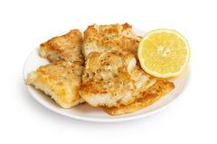 Frito en bacalaos de la harina en la placa Imagen de archivo libre de regalías
