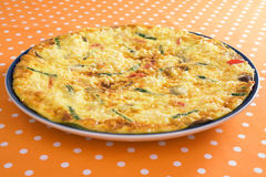 Frittata. With asparagus, red bell pepper, mushrooms, ricotta, and parmesan cheese stock photo