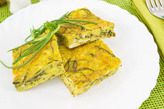 Frittata with agretti. Scrambled egg omelet with vegetables Stock Photography