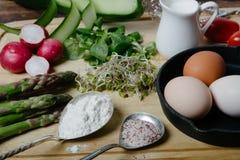 Frittata with asparagus ingridiens. Onion, tomato, herbs Stock Photos