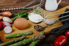 Frittata with asparagus ingridiens. Onion, tomato, herbs Royalty Free Stock Photos