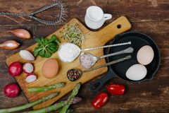 Frittata with asparagus ingridiens. Onion, tomato, herbs stock image