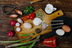Frittata with asparagus ingridiens. Onion, tomato, herbs stock images