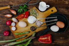 Frittata with asparagus ingridiens. Onion, tomato, herbs royalty free stock images