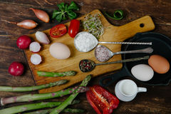 Frittata with asparagus ingridiens. Onion, tomato, herbs royalty free stock photography