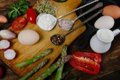 Frittata with asparagus ingridiens. Onion, tomato, herbs Royalty Free Stock Photo