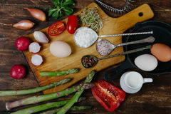 Frittata with asparagus ingridiens. Onion, tomato, herbs Stock Photo
