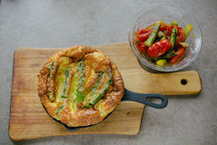 Frittata with asparagus. Ingridiens onion, tomato, herbs royalty free stock photography