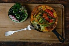 Frittata with asparagus. Ingridiens onion, tomato, herbs Royalty Free Stock Photos