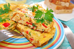 Frittata with chanterelle,onion,pepper and parsley Stock Photos