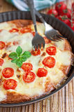 Frittata with cherry tomatoes Stock Photography