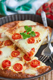 Frittata with cherry tomatoes Stock Photo