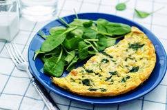 Frittata with chicken and spinach and fresh spinach Stock Photography