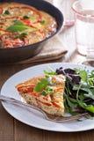 Frittata con las verduras y el jamón Foto de archivo libre de regalías
