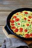 Frittata in a frying pan Royalty Free Stock Photos