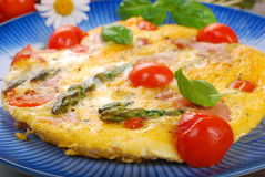 Frittata with green asparagus,ham and cherry tomato Stock Photo